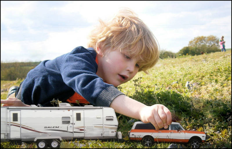 Boy-playing-with-burb-and-trailer
