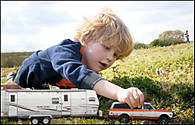 Boy-playing-with-burb-and-trailer.jpg
