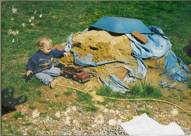 Name:  Sam in sand pile.jpg Views: 354 Size:  78.9 KB